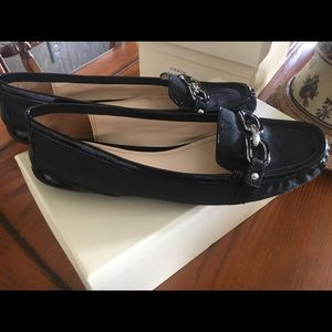 Black riding loafers by coach